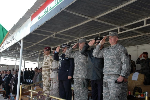 "Army Maj. Gen. Tony Cucolo (center), commander, United States Division-North, renders a salute with (left to right) Maj. Gen. Ayad of the 12th Iraqi Army Division, Brig. Gen. Sherko of the 1st Peshmerga Brigade, Maj. Gen. Jamal, Kirkuk Provincial Director of Police, Maj. Gen. Kawa, commander, Kirkuk Training Center, and Col. Larry Swift, commander, 1st Brigade Combat Team, 1st Armored Division, during a graduation and demonstration for the Combined Security Force, ""Golden Lions,"" at the Kirkuk Training Center, outside of Contingency Operating Site Warrior, Feb. 15.  (Photo by:  Sgt. 1st Class Tyrone C. Marshall  25th Combat Aviation Brigade Public Affairs)"