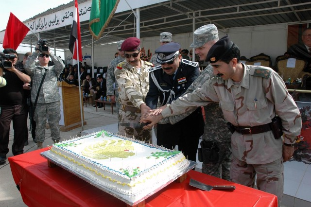 "Army Maj. Gen. Tony Cucolo (second from right), commander, United States Division-North, cuts a cake with (left to right) Maj. Gen. Ayad of the 12th Iraqi Army Division, Maj. Gen. Jamal, Kirkuk Provincial Director of Police, and Brig. Gen. Sherko of the 1st Peshmerga Brigade, to celebrate the Combined Security Force, ""Golden Lions,"" during their graduation and demonstration at the Kirkuk Training Center, near Contingency Operating Site Warrior, Feb. 15. Senior leaders of all the security forces in Kirkuk Province attended the event.  (Photo by:  Sgt. 1st Class Tyrone C. Marshall  25th Combat Aviation Brigade Public Affairs)"