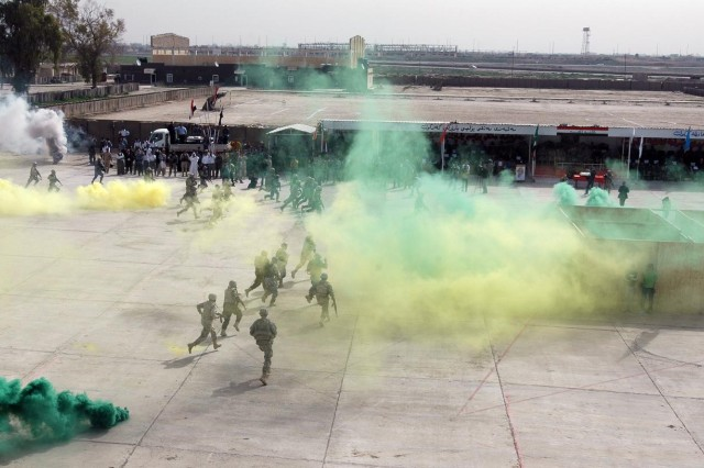 "Soldiers of the Combined Security Force, ""Golden Lions,"" simulate combat operations during a graduation and demonstration at the Kirkuk Training Center, outside of Contingency Operating Site Warrior, Feb. 15. The Golden Lions consist of Iraqi Army, Iraqi Police, Peshmerga Soldiers and U.S. forces from Kirkuk Province with the mission of providing security during the upcoming Iraqi elections.  (Photo by:  Sgt. 1st Class Tyrone C. Marshall  25th Combat Aviation Brigade Public Affairs)"