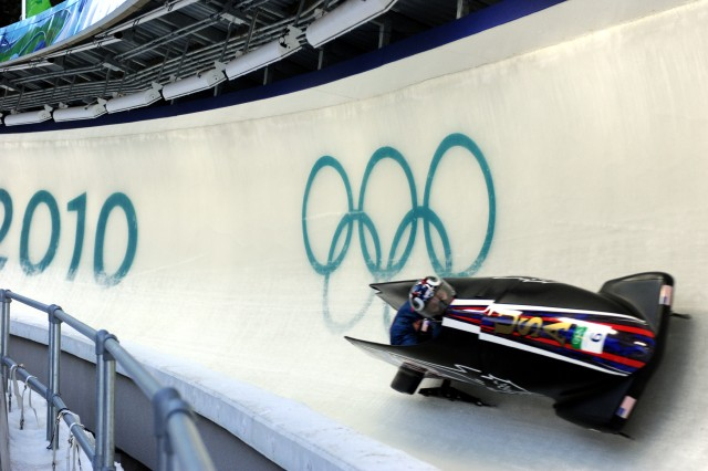 Bobsled pilot Steven Holcomb posts the sixth-fastest time of 51.89 seconds with Curt Tomasevicz aboard USA I in the first heat of the Olympic two-man bobsled competition Saturday at Whistler Sliding Center in British Columbia.