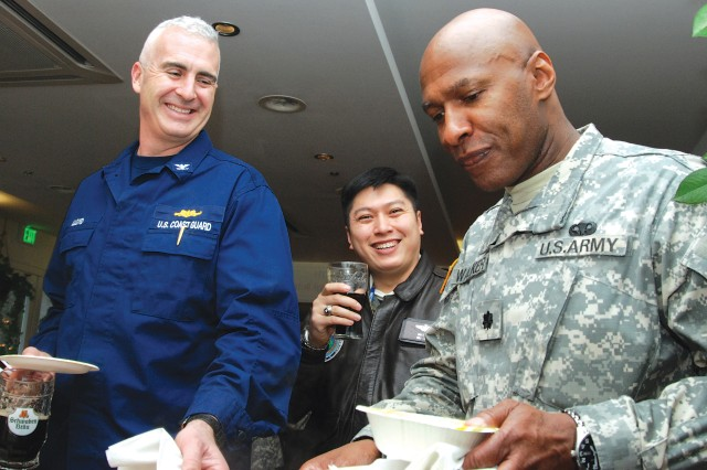 Coast Guard Capt. Craig Lloyd (from left), Air Force Maj. Van Thai and Army Lt. Col. Don Walker serve themselves some award-winning shrimp gumbo at the AFRICOM-sponsored Soul Food Cook-Off Feb. 5, which kicked off African-American/Black History Month.