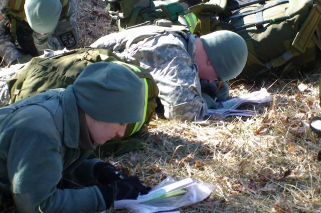 IU ROTC Cadets plot coordinates before beginning the land navigation training.