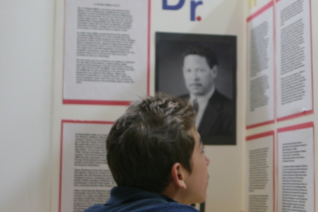 Ethan Smolinksi, 12, a seventh-grade student from Smith Middle School studies information about Dr. Walden, a black inventor. As part of the exhibit, youth were asked to write information and interesting facts about at least five of the inventors.