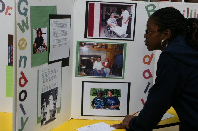 "Kiyanna Cage-Evans, 13, a seventh-grade student from Smith Middle School examines an exhibit about Gwendolyn Randall, who was a nurse, as part of The Black Inventors Exhibit, ""Dreams to Reality"".""I think it is important to learn our history,"" Cage-Evans said of the experience."