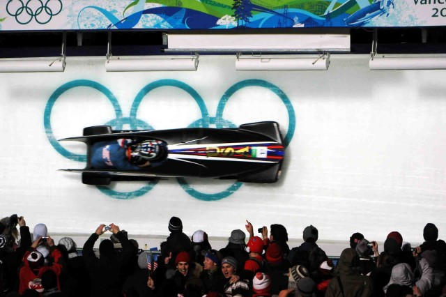 Former U.S. World Class Athlete Program bobsled driver Steven Holcomb pilots the USA-1 bobsled during competition at the Winter Olympics.