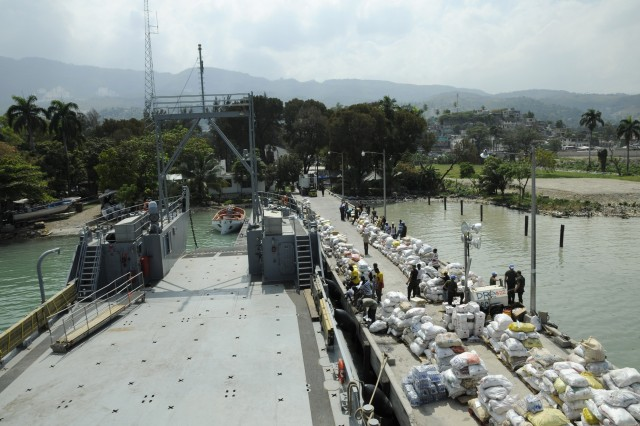 KILLICK, Haiti - A view from above Killick pier showing a variety of donated humanitarian assistance items.  The crew of Army LCU 2006 assisted local Haitians in downloading the items for transport to a local distribution site.   (U.S. Army photo by Sgt 1st Class Kelly Jo Bridgwater)