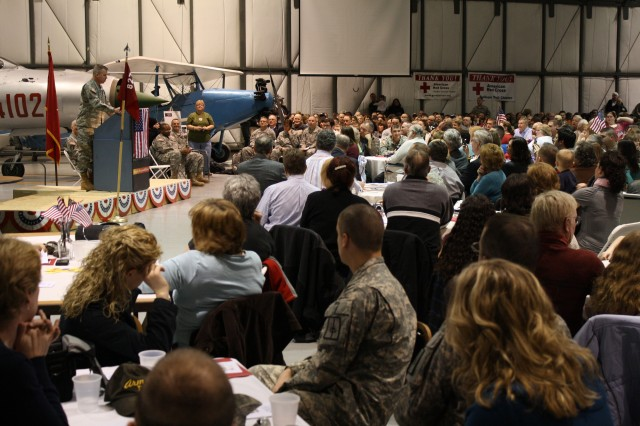 HORSEHEADS, NY-- New York Army National Guard Brig Gen. Michael C. Swezey, Commander, 53rd Troop Command, speaks to the Soldiers, family and friends of the 827th Engineer Co. at their deployment ceremony held February 21, 2010, at the Wings of Eagle Discovery Center, Elmira-Corning Regional Airport, Horseheads, NY.