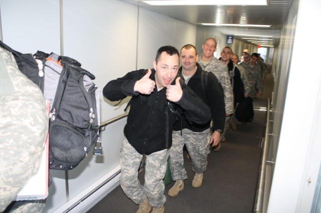 HORSEHEADS,NY-- New York Army National Guard Soldiers of the 827th Engineer Company board a chartered jet at the Elmira-Corning Regional Airport in Horseheads, NY, February 21, 2010. The unit is enroute to Fort McCoy, Wisconsin, for additional training before heading off for a 10 month deployment in support of Operation Enduring Freedom