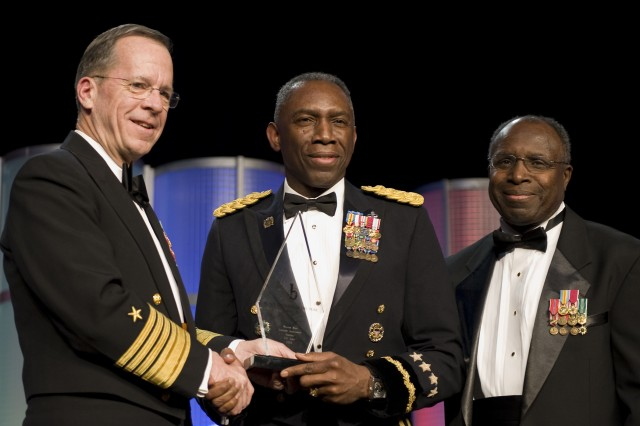 "Chairman of the Joint Chiefs of Staff Adm. Mike Mullen and Gen. (ret.) Johnnie Johnson present Gen. William ""Kip"" Ward with the Lifetime Achievement Award at the 24th Annual Black Engineer of the Year Awards, Feb 20."