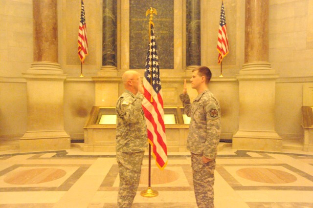 """Staff Sgt. Jason Buscovich (right) takes the enlistment oath during his re-enlistment ceremony at The National Archives in Washington,DC on Feb. 18, 2010.  Buscovich is the enlisted aide to Maj. Gen. Karl R. Horst, commanding general Joint Force Headquarters/ National Capital Region and the U.S. Army Military District of Washington (right).  The National Archives preserves and provides access to the records of the Federal Government including The Declaration of Independence, The Constitution and the Bill of Rights. Boscovich said the ceremony had special meaning for him. """"For me to take the enlistment oath to support the Constitution while looking at the actual document, is pretty humbling."""""""