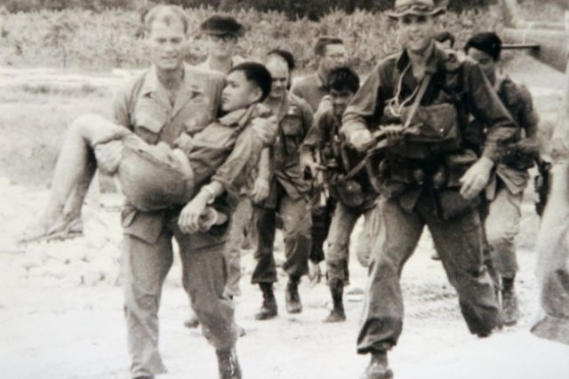 Then Sgt. 1st Class Robert L. Howard carries a North Vietnamese Army prisoner of war. Howard is a Medal of Honor recipient and one of America's most decorated Soldiers. Howard retired from the Army in 1992 as a colonel, after having served 36 years on active duty. He died Dec. 23, 2009, and was buried Feb. 22, in Arlington National Cemetery. (Photo used with permission by rlhtribute.com)