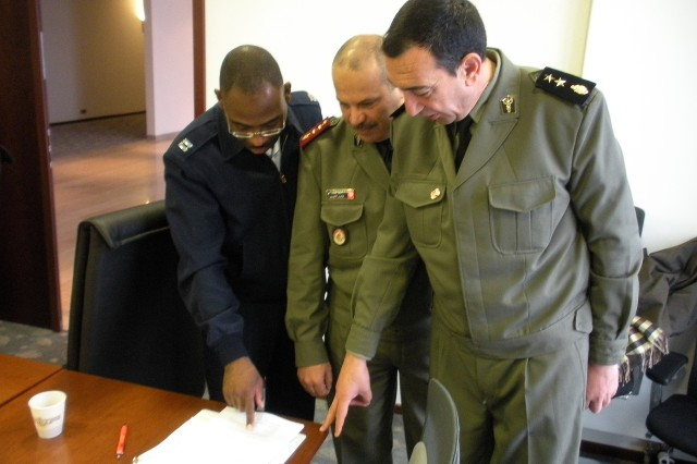 RAMSTEIN AIR BASE, Germany - (Left to right) Captain Terrence Kilgore, Air Force liaison officer with the U.S. Embassy in Tunisia, reviews exercise plans with Tunisian Forces Colonel Khaled Lamine and Lieutenant Colonel Khaled Baltage, January 2010. The three were taking part in a recent planning conference for a medical and disaster response exercise being coordinated by 17th Air Force (Air Forces Africa). The exercise, scheduled to take place in April, will include participation from the Wyoming and Nevada Air National Guards. As the air component for U.S. Africa Command (AFRICOM), 17th Air Force has been designated that lead component for the exercise.