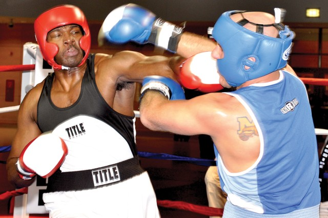Baumholder's Kirk Robinson (left) tags Wiesbaden's Darius Boscanino during the final bout at the Black History Month Boxing Tournament in Wiesbaden Feb. 6.