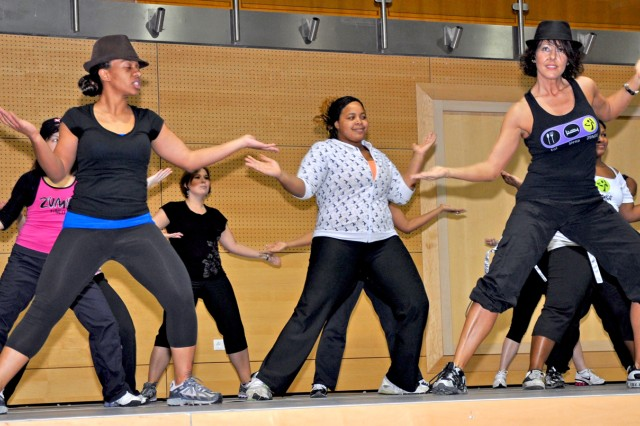 Maria Diaz leads a Zumba session to entertain the boxing crowd during intermission.