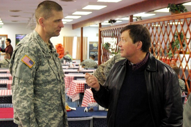 North Dakota Representative Earl Pomeroy talks with Brig. Gen. Al Dohrmann, Multi-National Battle Group-East commander, at Camp Bondsteel, Kosovo, on Feb. 21.