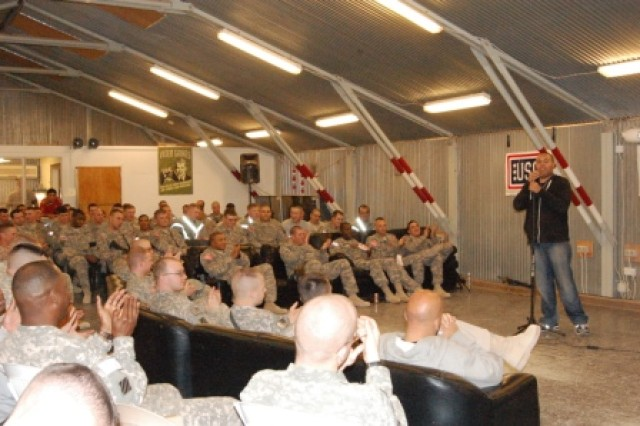 Comedian Chase Durousseau entertains Soldiers of the 1st Battalion, 15th Infantry Regiment, 3rd Heavy Brigade Combat Team, 3rd Infantry Division, and attached unit Soldiers and civilians during a comedy show Feb. 13, 2010, at Contingency Operating Base Echo, Iraq.