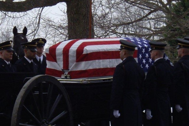 "Soldiers from the 3rd Infantry Regiment ""The Old Guard"" render military honors at the funeral of Col. Robert L. Howard, one of America's most highly decorated Soldiers.  Howard was laid to rest in Arlington National Cemetery Feb. 22, after serving his country for nearly half a century."