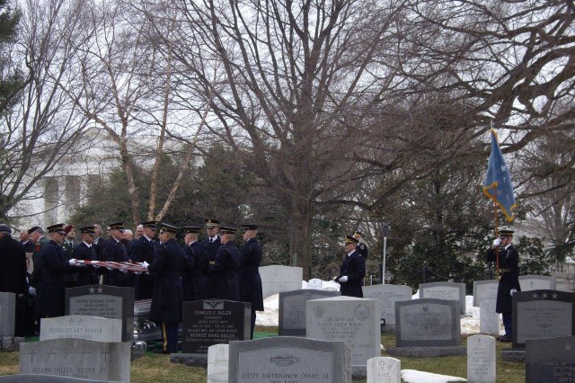 "Soldiers from the 3rd Infantry Regiment ""The Old Guard"" fold the American flag at the funeral of Col. Robert L. Howard at Arlington National Cemetery Feb. 22."