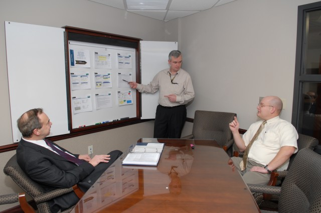 From left, Joseph Maciejewski, Charles Martin and Russel Dunkelberger discuss new process improvements for tracking mandatory safety training.