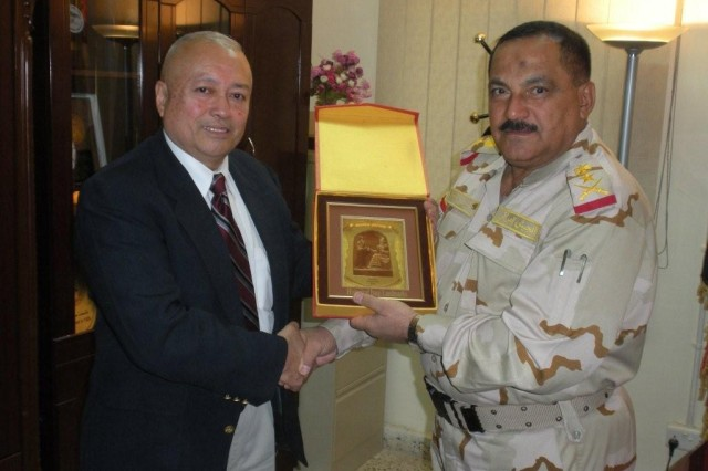 Carlos Legoas, left, poses with Lt. Gen. Hussein-Dohe, commander of the Iraqi Training Directorate Command, in Dec. 2009, before Legoas returned to the United States. Legoas spent more than two years working with the Iraq Training and Advisory Mission-Army and the Iraqi Ground Forces Command to establish an enduring noncommissioned officer education system for Iraq's forces.