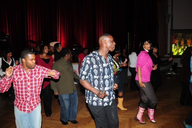 """Community members and guests do the """"Electric Slide"""" dance during the """"A Taste of Soul"""" event at the Heidelberg Arts and Cultural Center. The event was one of several held in the Heidelberg community in honor of Black History Month."""