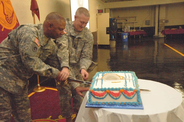 Command Sgt. Maj.C.C. Jenkins, Jr., U.S. Army Combined Arms Support Command and Fort Lee (left), and Sgt. Maj. David Simpson, deputy director of The White House Transportation Agency (right), cut the Centennial cake. February 17, 2010.