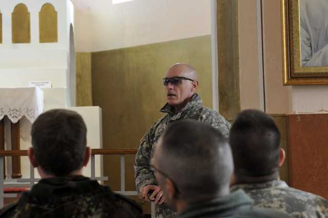 Chaplain (Capt.) Timothy Meier, Los Altos, Calif., chaplain for MNBG-E's 1-144 Maneuver Task Force, gives a tour of the Church of the Black Madonna in Letnica during the monthly KFOR chaplains' conference Feb. 19.  The conference was hosted by Multi-National Battle Group-East.