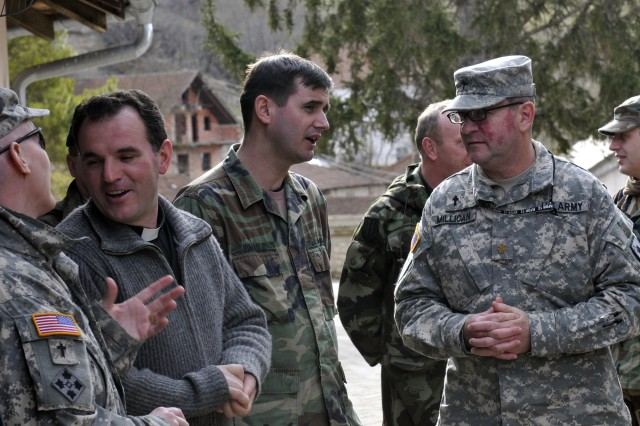 Chaplain (Maj.) Maury Millican (right) talks with participants at the monthly KFOR chaplains\' conference Feb. 19. Millican is command chaplain for Multi-National Battle Group-East, which hosted the conference.