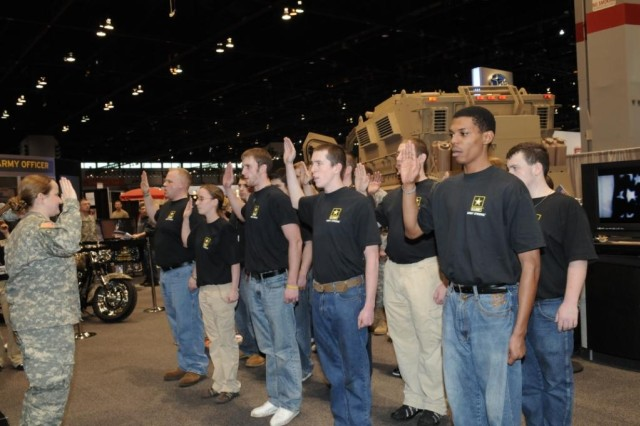 Capt. Nancy Cech, Chicago Recruiting Battalion, Downers Grove Recruiting Company, administers the Oath of Enlistment to future Soldiers on the opening day of the 2010 Chicago Auto Show in the U.S. Army Exhibit area.