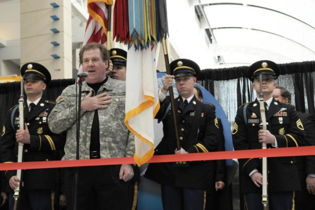 Soldiers from the Chicago Recruiting Battalion, Downers Grove Recruiting Company, present the nation's colors, while Gold-Star family member Joe Cantafio, '101st Rock Division Band' sings the National Anthem at the 2010 Chicago Auto Show Opening Ceremony and Ribbon Cutting.  Pictured from left to right are: Staff Sgt. Joseph Beard, Staff Sgt. Shaun Kackert, Staff Sgt. Michael Kasper and Staff Sgt. Roy Painter.