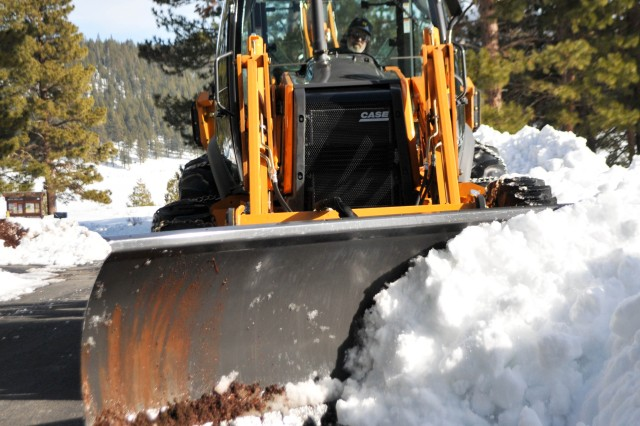 Dale Verner, dam operator and maintenance worker at Martis Creek Dam near Truckee, Calif., plows snow from one of the park roads after a major snowstorm in the Sierra Nevada Mountains.