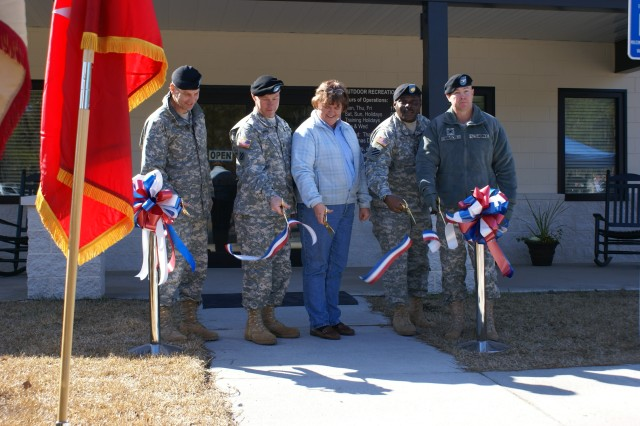 Brigadier General Jeffrey Phillips, 3rd ID Deputy Commanding General-Rear; Command Sgt. Maj. Jeffrey Ashmen, Command Sergeant Major-Rear; Susan Chipple, Outdoor Recreation Supervisor and Recreation Specialist; Garrison Command Sgt. Major James E. Ervin; and Garrison Commander Col. Kevin Milton cut a ribbon to celebrate the completion of extensive renovation at Holbrook Pond Recreation Area and the Outdoor Recreation Center, Feb. 17.