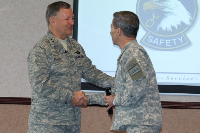 Maj. Gen. Frederick Roggero, Air Force Chief of Safety and Commander of the Air Force Safety Center, left, greets Brig. Gen. William T. Wolf, Director of Army Safety and U.S. Army Combat Readiness/Safety Center Commanding General, Feb. 23 during the opening day of the Army Senior Safety Symposium at Fort Rucker, Ala. Roggero told symposium attendees that joint safety operations are going to be critical as the Department of Defense continues to transform.
