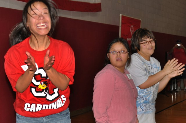 Reina Herrara (far left) explodes with high emotion after hearing she has won a medal during the Special Olympics 2010 Basketball Tournament at the Jimmy Brought Fitness Center. Gloria Mireles (center) and Dalia Martinez clap for her.