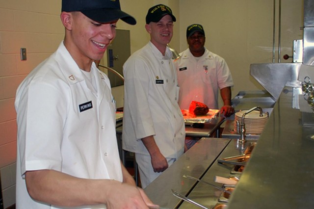 Soldiers operate the serving line at the 1-25th SBCT Wolves' Den re-opening ceremony Feb. 18, 2010.