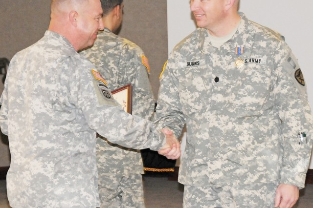 Brig. Gen. Kelly J. Thomas, USAACE and Fort Rucker deputy commanding general, presents 1st Bn., 212th Avn. Regt. Commander Lt. Col. Michael Burns with a plaque Feb. 17 commemorating his Air Medal.