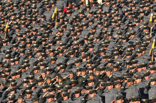 Cadets from the U.S. Military Academy at West Point, N.Y., render honors during the playing of the national anthem before the start of the 110th Army Navy game at Lincoln Financial Field in Philadelphia, Pa., Dec. 12, 2009.