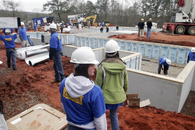 Volunteers work at the build site for the Extreme Makeover: Home Edition season finale Tuesday in Pine Mountain Valley, Ga.