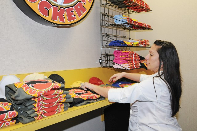 Kristina Howell, bingo and promotions manager, arranges souvenir items for Mother Rucker's, a new sports bar being planned for the installation. The facility, to be located near the InterContinental Hotels Group building, will offer adult beverages, hamburger and hot dog bars and an outdoor patio.
