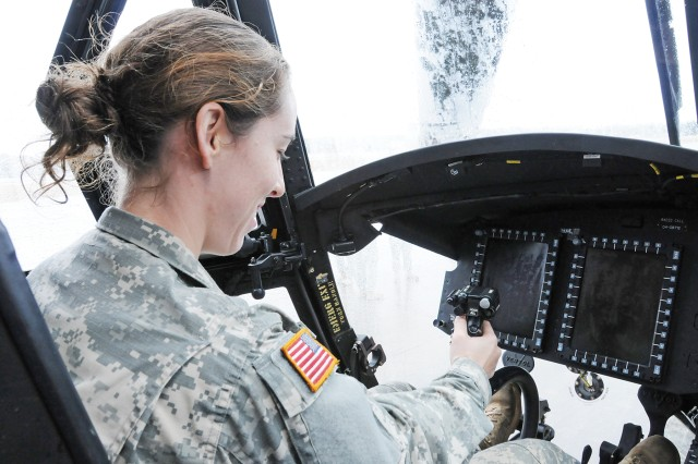 Second Lt. Mia Odom, D Co., 1st Bn., 145th Avn. Regt., examines a CH-47F Chinook cockpit for the first time Feb. 5 as part of a Knox Army Heliport flight school class tour at Fort Rucker.