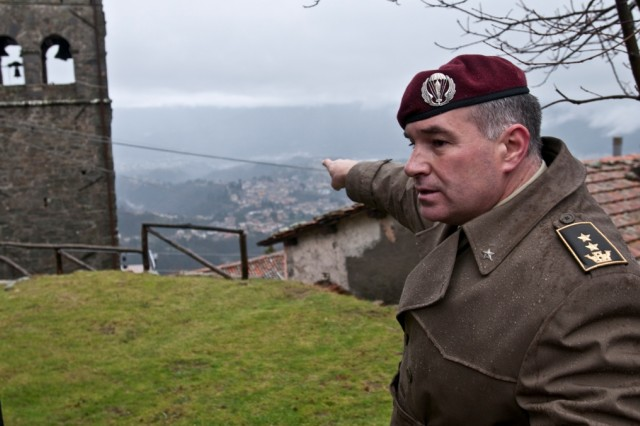 Italian Lt. Col.Vittorio Lino Biondi, co-author of La Battaglia di Sommocolonia, shows where the American troops were amassed in the Serchio valley in relation to Lieutenant Fox's forward observing position.
