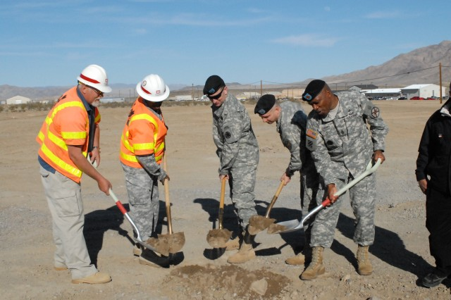 "Fort Irwin/National Training Center Commanding General Brig. Gen. Robert ""Abe"" Abrams (center) joins Fort Irwin Garrison Commander Col. Jim Chevallier (second from right) and Fort Irwin Garrison Command Sgt. Maj. Mark Harvey (far right) in breaking ground on new barracks and company headquarters facilities on Feb. 25, 2010 at Fort Irwin, Calif."