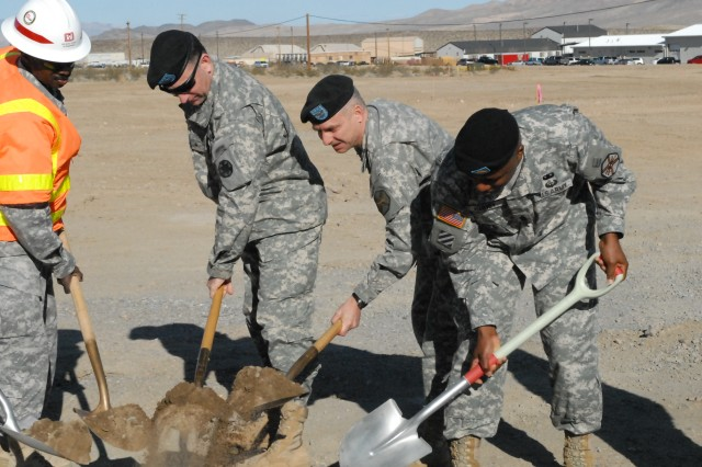"Fort Irwin/National Training Center Commanding General Brig. Gen. Robert ""Abe"" Abrams (second from left) joins Fort Irwin Garrison Commander Col. Jim Chevallier (center) and Fort Irwin Garrison Command Sgt. Maj. Mark Harvey (far right) in breaking ground on new barracks and company headquarters facilities on Feb. 25, 2010 at Fort Irwin, Calif."