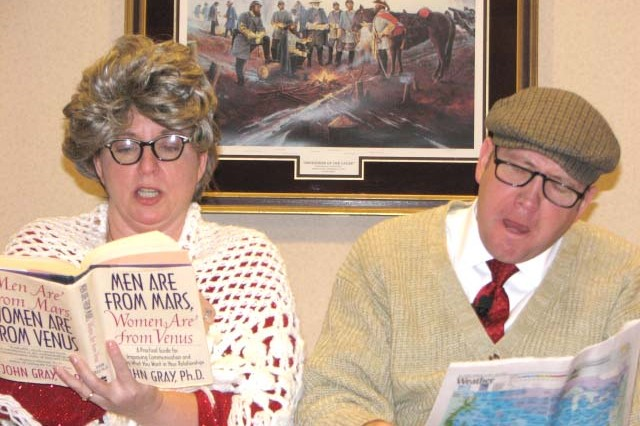 Debby and Jeff McElroy, cofounders of the Forever Families ministry, perform a skit dressed as an elderly couple during a community Valentine dinner held Feb. 19 at The Commons at Fort McPherson. The couple, who have been married for 25 years, launched their ministry to help other couples grow closer and to help strengthen Families across the nation.