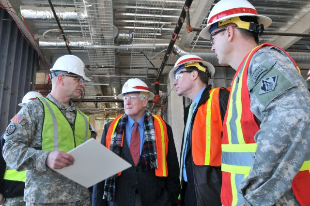 Installation Commander Col. Jerry L. Blixt, discusses features of the new Fort Belvoir Community Hospital with Rep. Jim Moran. D-Va., 8th District, Sen. Mark Warner, D-Va.; and District Engineer Col. Andrew Backus, Norfolk District, North Atlantic Division, U.S. Army Corps of Engineers. Warner and Moran visited the construction site Thursday.