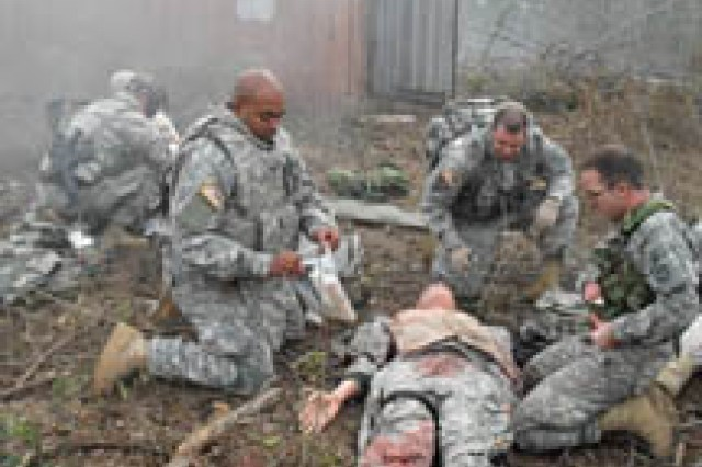 Sgt. 1st Class DeMarco Newton performs first aid on a mannequin during the advanced trauma lane portion of combat advisor training with the 162nd Inf Bde.