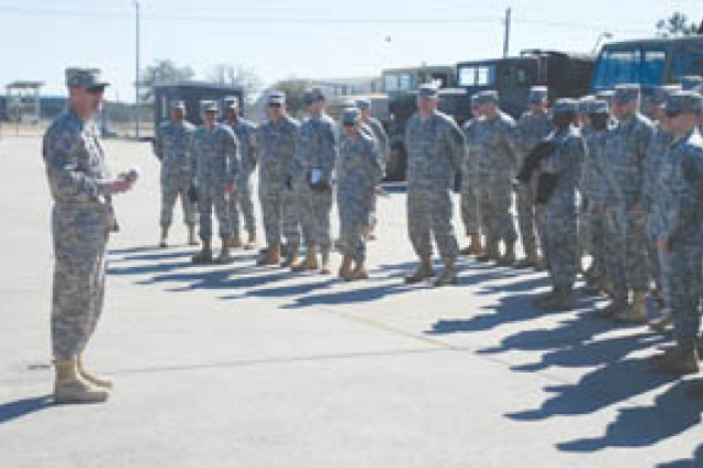 Col. Eric Brigham, commander, 48th Chem Bde, addresses company commanders and first sergeants Feb. 17 in the 83rd Chemical Battalion motorpool. Leadership from across the brigade gathered at Fort Polk to share techniques.
