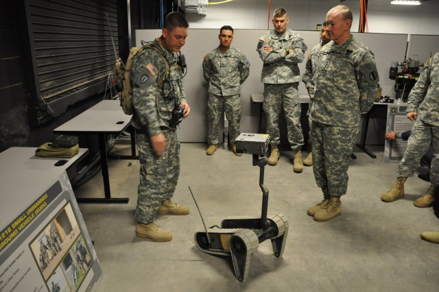 Sgt. William J. Heuisler, 2nd Combined Arms Battion, 5/1 Armor, Army Evaluation Task Force, left, discusses features of the Small, Unmanned Ground Vehicle with TRADOC Commander Gen. Martin E. Dempsey, right, in the Battle Command Complex during a recent visit to Fort Bliss, Texas.
