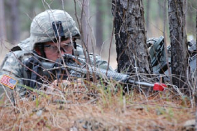 "2nd Lt. Garrett Anderson, platoon leader, 687th Engineer Co, 46th Eng Bn, 1st MEB, provides security during a road march as part of the Steel Spike Challenge Feb 11. The challenge was held for the senior leaders of the 46th Engineer Battalion to test their tactical and technical knowledge and give them little reminder that all Soldiers are ""shooters first."""
