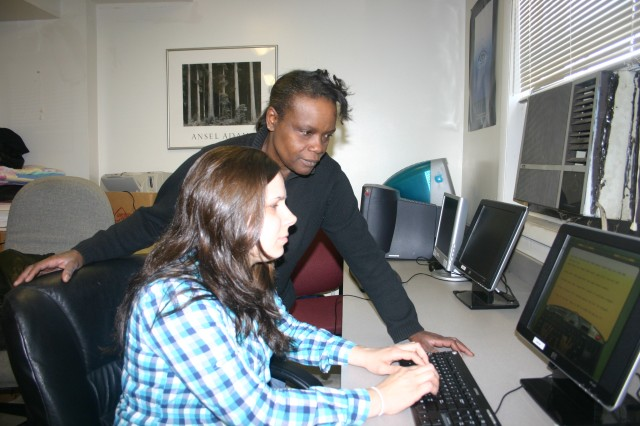 Melanie Sanderson (seated), a guest at Sarah's House, logs onto one of the software programs at the computer lab as another guest, Jacqueline Parker, looks on. Sarah's House will use grant money awarded to offer online pre-GED and GED classes in the lab.